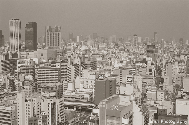 The View North.<br /> From the Tsutenkaku Tower.<br /> Note Film Shot: Nikon F80 + 50f/1.8 + R1 Red Filter + Kodak 400 TMax Film.<br /> Split toned with the Gimp.