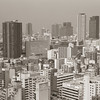 The View Towards Namba.<br /> From the Tsutenkaku Tower.<br /> Note Film Shot: Nikon F80 + 50f/1.8 + Y2 Yellow Filter, Kodak 400 TMax Film.<br /> Split toned with the Gimp.