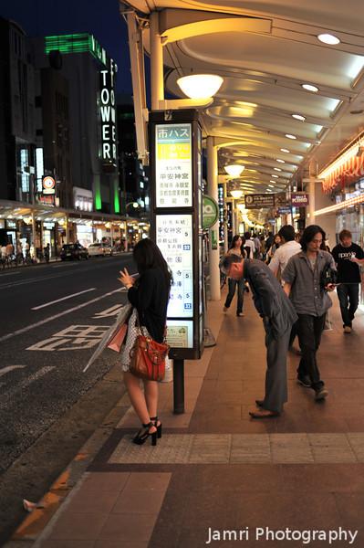 At a bus stop on Kawaramachi-dori.