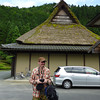 Me in Miyama.<br /> Outside one of the thatched roof buildings, although the lower section of this building looks rather modern.<br /> Photo by Ritsuko.