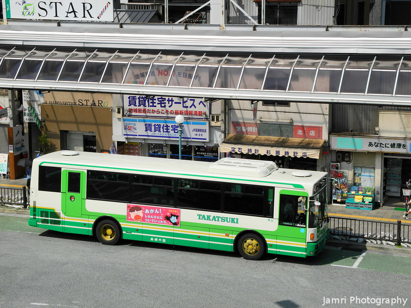 A Green Takatsuki Bus.