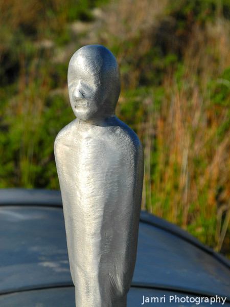 Metal Man.<br /> These metal figures were on each of the public artworks as some kind of symbol/signature of the artist.