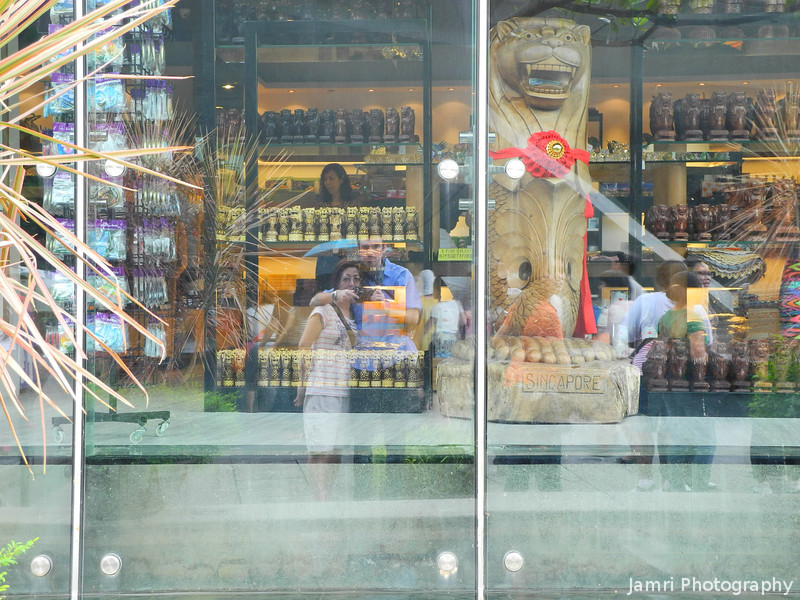 Our Reflection in a Souvenir Shop Window.<br /> Us in Singapore.