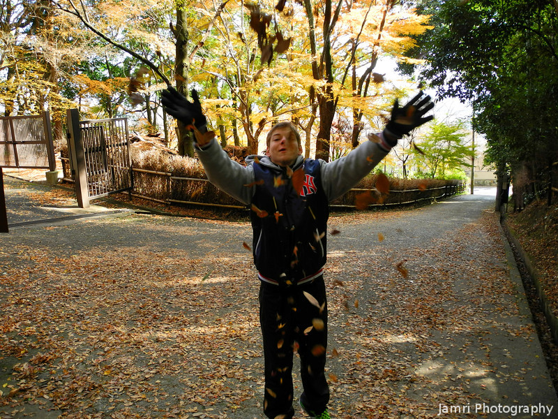 Jayden celebrating the fallen leaves.<br /> Like me he's from Perth, Australia and we don't get such wonderful autumn colour there as we do here in Kyoto.