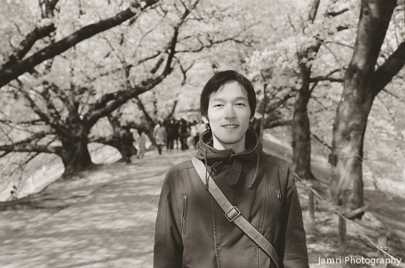 Takashi under the Sakura at Yawata.<br /> Note Film Shot: Nikon F80 + 50f/1.8 + PO1 Green Filter, Kodak 100 TMax Film.<br /> Split toned with the Gimp.