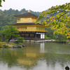 The Temple of the Golden Pavilion on a rainy day in May.<br /> The rain didn't keep the crowds away, it just made it worse cause you had to deal with avoiding other peoples umbrellas. The only times Kinkaku-ji has been quiet for me is on cold winters days as long as it's not coated in snow for that will bring the crowds too.