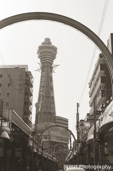 Towards the Tsutenkaku Tower.<br /> Note Film Shot: Nikon F80 + 50f/1.8 + Y2 Yellow Filter, Kodak 400 TMax Film.<br /> Split toned with the Gimp.