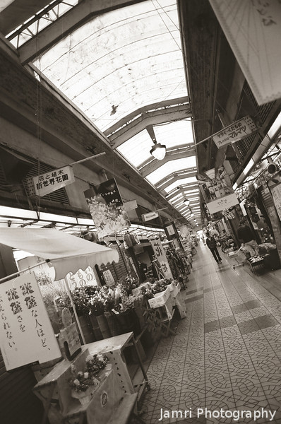 Quiet Markets.<br /> The Shinsekai Markets in Osaka have seen better days, especially since it was taken on a Sunday afternoon which is normally the busy time for shops in Osaka.<br /> Note Film Shot: Nikon F80 + 24f/2.8 + Y2 Yellow Filter, Kodak 400 TMax Film.<br /> Split toned with the Gimp.