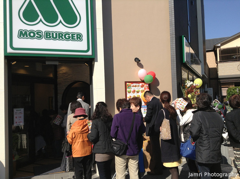 Part of the Queue.<br /> I didn't bother going on opening day, since I've had MOS Burger plenty of times.