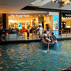 A canal in a shopping center.<br /> At the Marina Bay Sands Resort in Singapore.