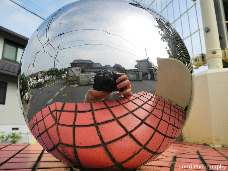 Self Portrait in a Shiny Sphere.