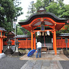 Worshipper at a Shrine.<br /> In the Fushimi Inari-taisha Shrine complex.