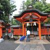 Worshipper at a Shrine.<br /> In the Fushimi Inari-taisha Shrine complex.