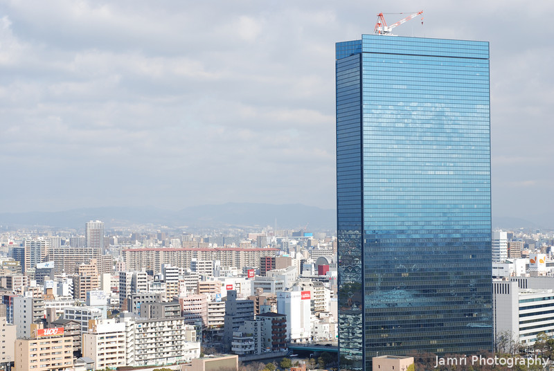The Reflective Building.<br /> This building stands out like a sort thumb, because it so much taller and uses much more glass than the other buildings around here or in Japan for that matter.