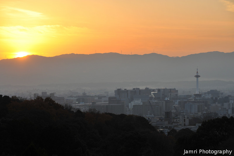 The Sun setting behind the mountains of Kyoto.