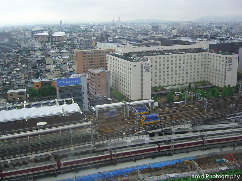From the top of the Kyoto Train Station.<br /> We brought our friends to Kyoto Station and I took this shot looking towards the New Miyako Hotel.