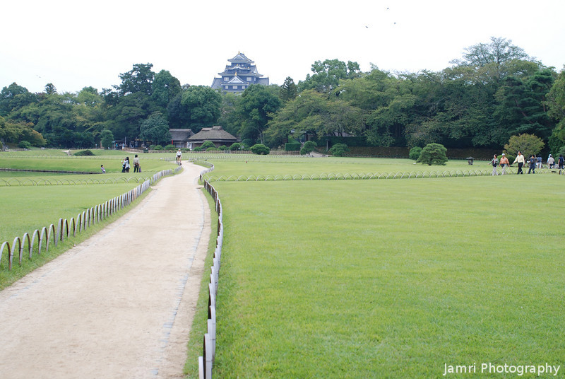 "Korakuen Garden with borrowed Castle Scenery.<br /> Some gardens in Japan like to ""borrow"" scenery, that is incorporate scenery that is located physically outside the garden as backdrop. Korakuen in Okayama borrows Okayama Castle."