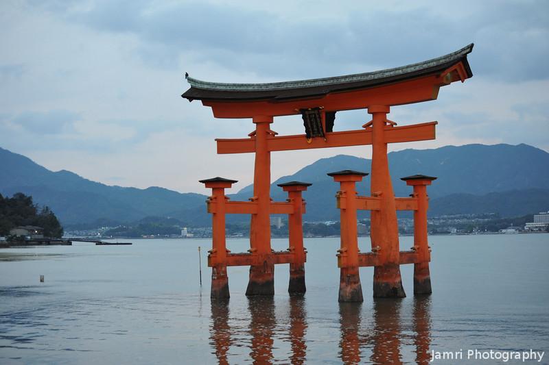 Still waters under the Torii.