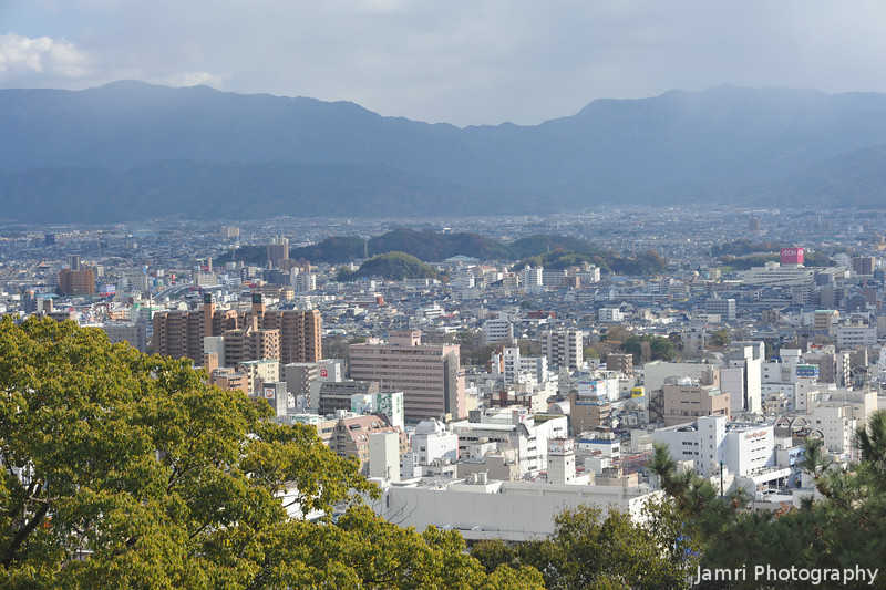 Matsuyama City from the Castle Hill.<br /> Looks like a bit of distant snow fall (top right).