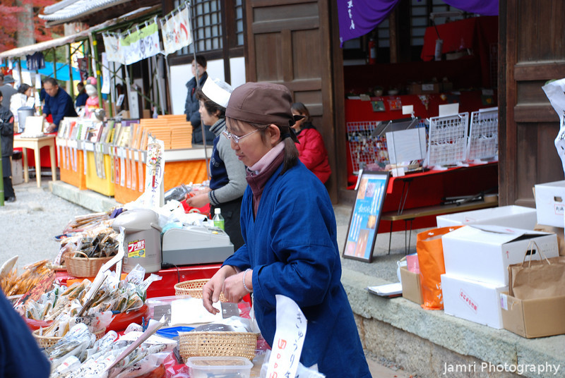 Mixing Religion and Commerce.<br /> With the influx of visitors to Komyo-ji (a Buddhist Temple in Nagaokakyo) for the momiji (Japanese Maple) colour change, numerous food and other stores were set up in the lower temple courts.