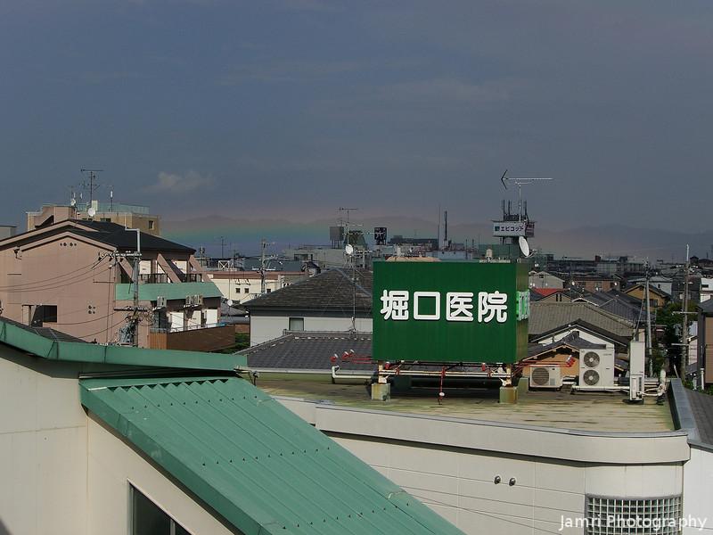A low lying rainbow.<br /> From Nagaoka Tenjin Station, in Nagaokakyo, Kyoto-fu, Japan.