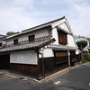 House on the Corner.<br /> One of the traditional style houses in Kurashiki, this photo also shows just how bad state some of the roads are in.