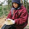 Looking on<br /> Ritsuko reads the words of the poems that are being recited by a group of elderly men at Mt Tennozan on New Years Morning.<br /> Note Film Shot: Nikon F80 + Nikkor 50 f/1.8 + Fujicolor PRO400