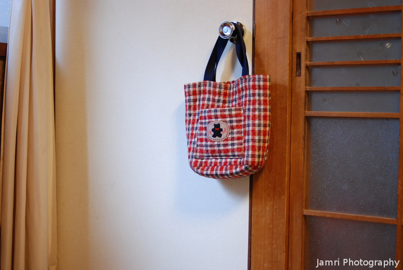 Bag hanging on a handle.<br /> Everyday scenery from our Japanese house. BTW that's the door to the storage cupboard under the stairs.