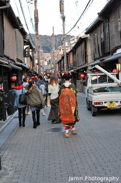 The Getaway.<br /> A Maiko (Apprentice Geisha) in a hurry on her way to an appointment.
