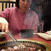 "Cooking Yakiniku at Den. Yep, we finally had a meal at <A href=""http://jamri.smugmug.com/keyword/den"">Den Yakiniku Restaurant</A>, after it has been so often a subject in my photographs. ...and it was good!"