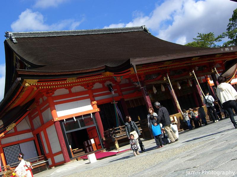 The Low Down at the Big Shrine.<br /> Yasaka-jinja, Gion, Kyoto.