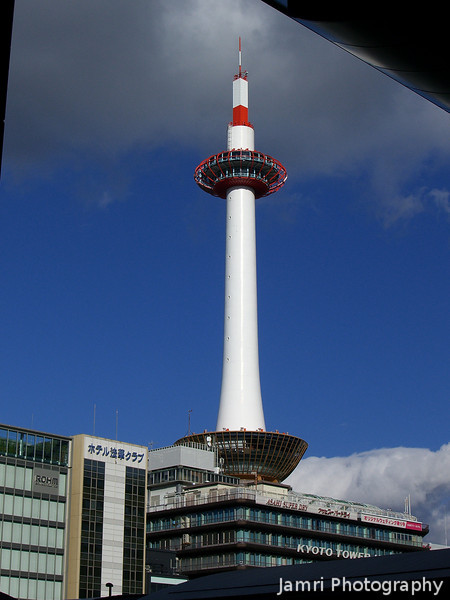The Kyoto Tower with a big cloud behind it.