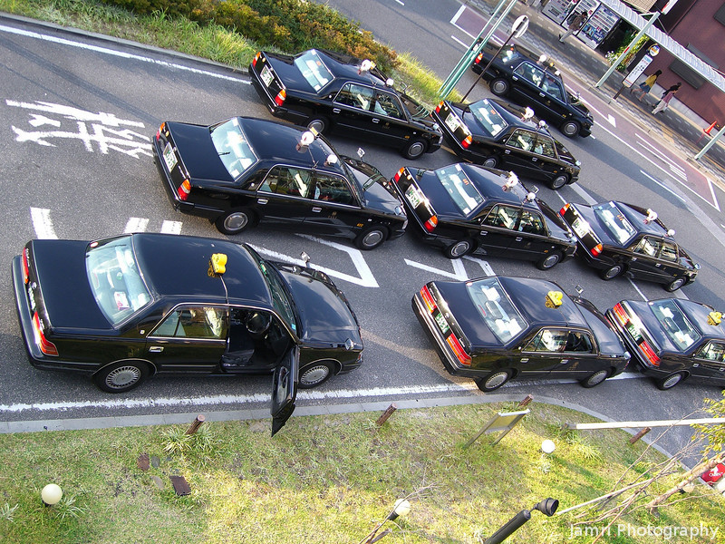 Taxis in a rank.<br /> At JR Nagaokakyo Station.