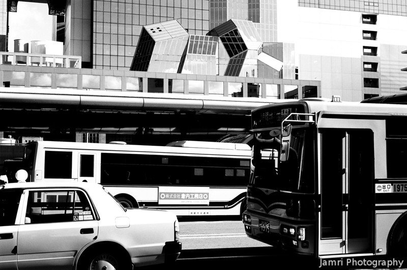 Hot in the City.<br /> Just after arriving in Kyoto Station from Arashiyama.<br /> This is the last in this little B&W series, I hope you enjoyed the journey. Back to colour for a while...<br /> Note Film Shot: Nikon F80 + 50f/1.8 + Orange Filter + Fujifilm Neopan Acros