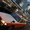 A Big White and Orange Taxi.