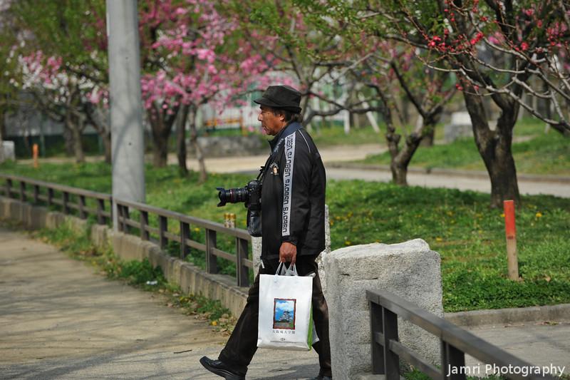 Photographer Walking.
