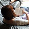 Ritsuko Relaxing with a Book.<br /> During our 4 day camping vacation.