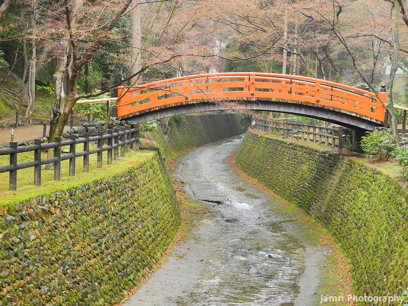 Bridge over a stream.<br /> At Kitano Tenmangu Shrine, Kyoto.