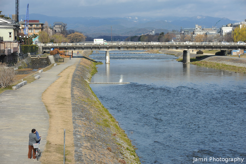 Looking Up the Kamogawa (Kamo River).<br /> A bit of snow on Kitayama (North Mountains).