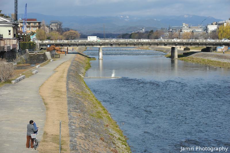 Looking Up the Kamogawa (Kamo River).<br /> A bit of snow on Kitayama (North Mountains).