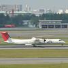 Landed.<br /> A JAL De Havilland Canada, DHC-8-402Q Dash 8 (DH8D)