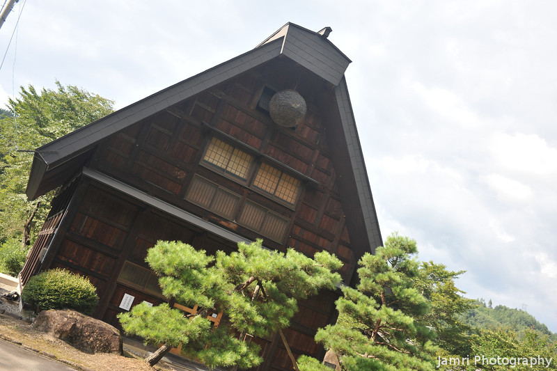 A Gassho Zukuri (praying hands) building without the thatched roof.<br /> Maybe they got sick of having to keep redoing the thatching every few years.