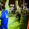 Ice Sculptures Under Construction.<br /> It seems a little dangerous to be using electric chainsaws on ice and having metal scaffolding?