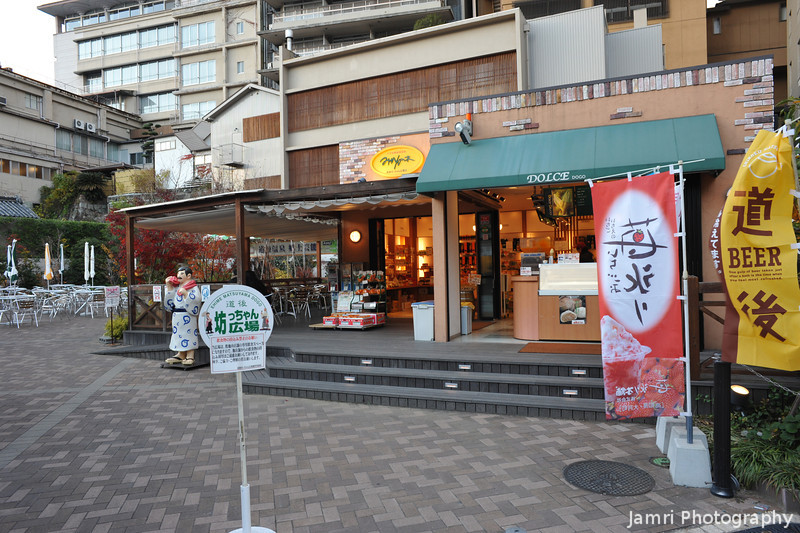 Outdoor Eating.<br /> Not in this season!<br /> To the left behind the sign there a porcelain statue, I wonder if it's supposed to be Botchan.