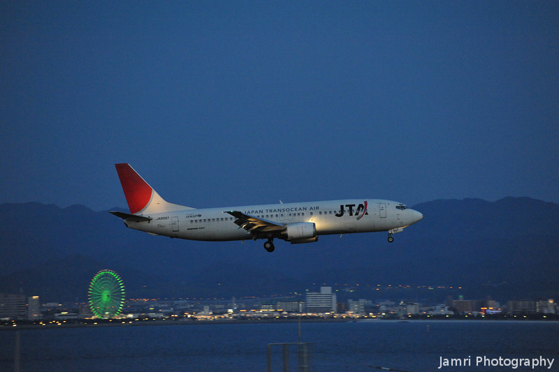 With Ferris Wheel in the Background.<br /> A JTA (Japan Transocean Air) Boeing 737-4Q3, Rego: JA8597.