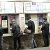 A the ticket machines.<br /> Hankyu Saiin Station.