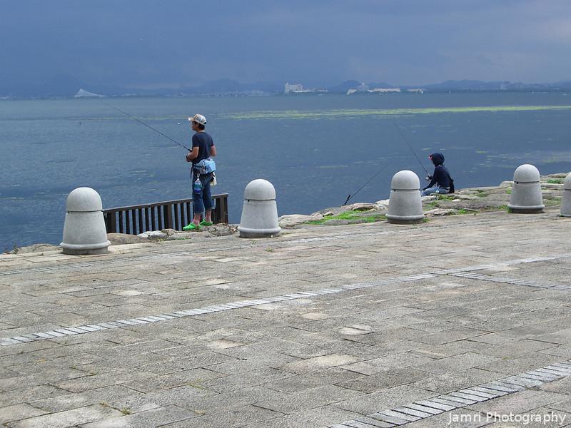 Fishing on the shore of Biwa-ko.