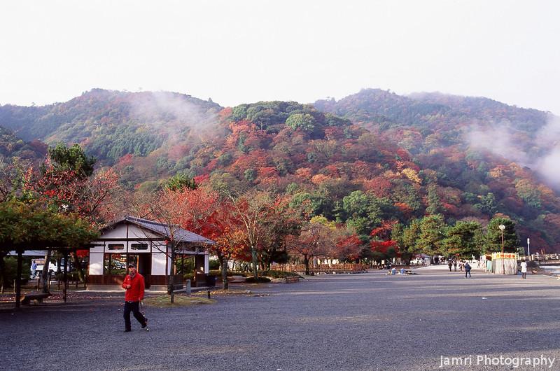 Towards the Hills.<br /> The Hills of Arashiyama in Autumn Colour.<br /> Note Film Shot: Nikon F80 + Nikkor 35 f/2 + Fujichrome Velvia