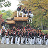 Stopping for a photo.<br /> On of the Floats during the Culture Day Parade at Osaka Castle grounds.