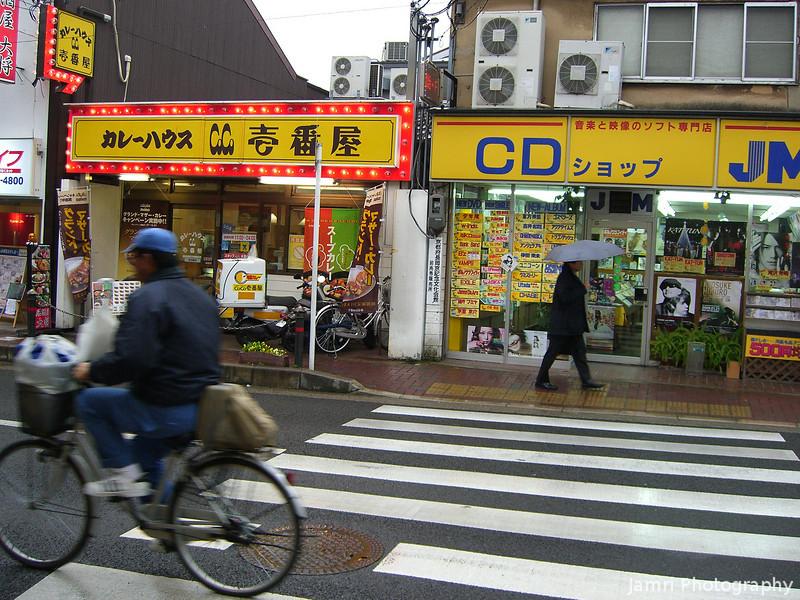 Rainy Day Street Scene.<br /> Near the Hankyu Nagaoka Tenjin Station.